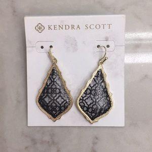 Kendra Scott black and gold earrings.